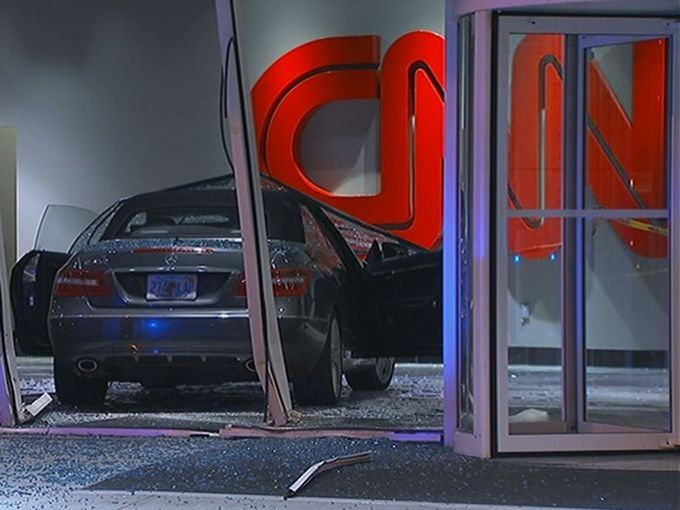 Car crashes into CNN Center