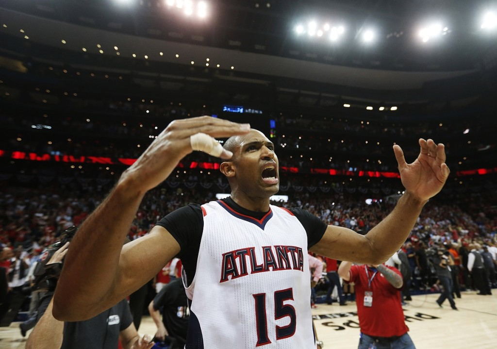 Atlanta Hawks' Al Horford celebrates after the Hawks beat the Washington Wizards 82-81 in Game 5 of the second round of the NBA basketball playoffs Wednesday, May 13, 2015, in Atlanta. (AP Photo/John Bazemore)