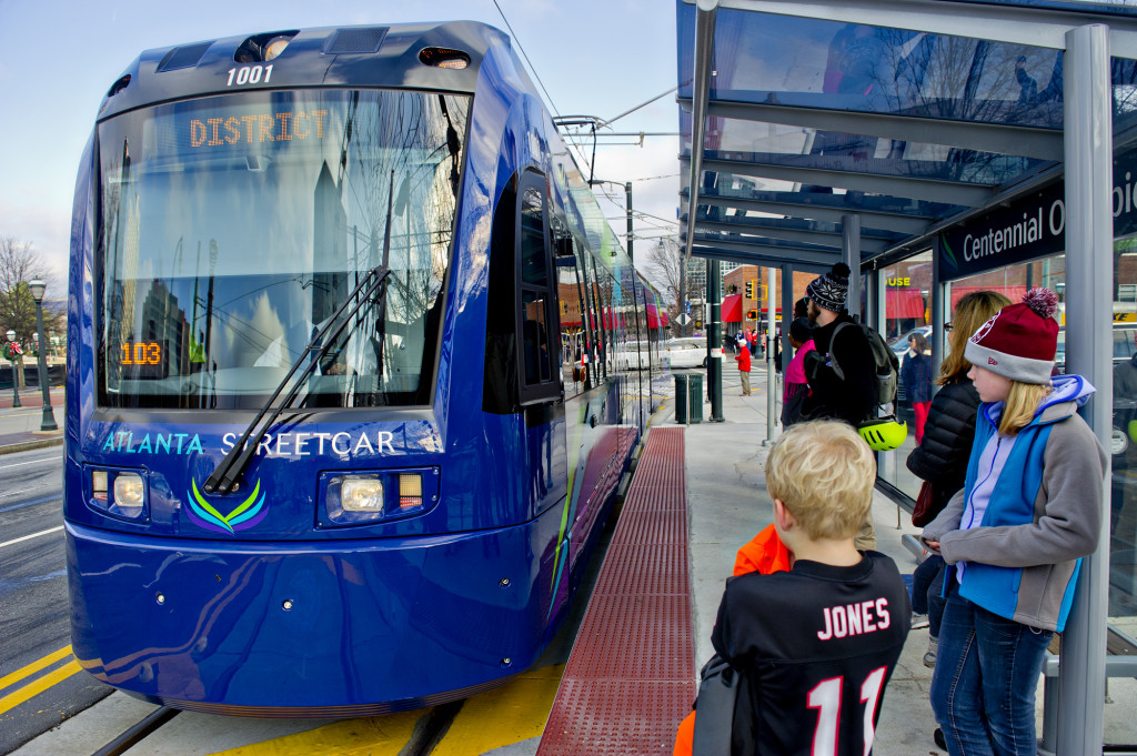 December 31, 2014 Atlanta - Shelby Jones (right) and her brother Dalton wait at the Centennial Olympic Park stop as an Atlanta Streetcar pulls up on Wednesday, December 31, 2014. Each streetcar can hold up to 200 riders. The new service takes about 30 minutes to make a round trip for each of the 12 stops.    JONATHAN PHILLIPS / SPECIAL