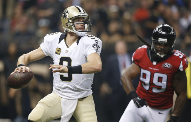 New Orleans Saints quarterback Drew Brees (9) works as Atlanta Falcons defensive end Adrian Clayborn (99) pursues during the first half of an NFL football game, Thursday, Oct. 15, 2015, in New Orleans. (AP Photo/Gerald Herbert)