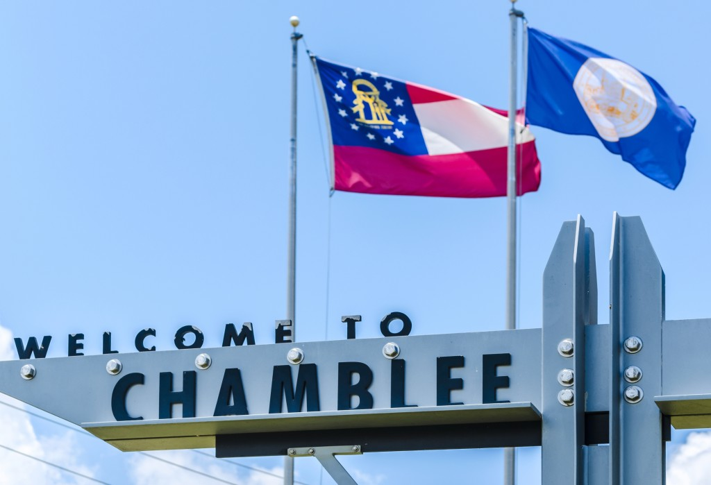 """A welcome sign hangs outside Chamblee City Hall in Chamblee, Georgia, June 10, 2014. Chamblee was incorporated in 1907 and had a population of 9,892 people according to the 2010 U.S. Census. The city's motto is, """"A City on the Right Track."""" (Photo by Carmen K. Sisson/Cloudybright)"""