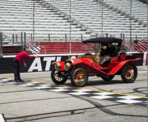 A car from 1909 runs a lap at Atlanta Motor Speedway