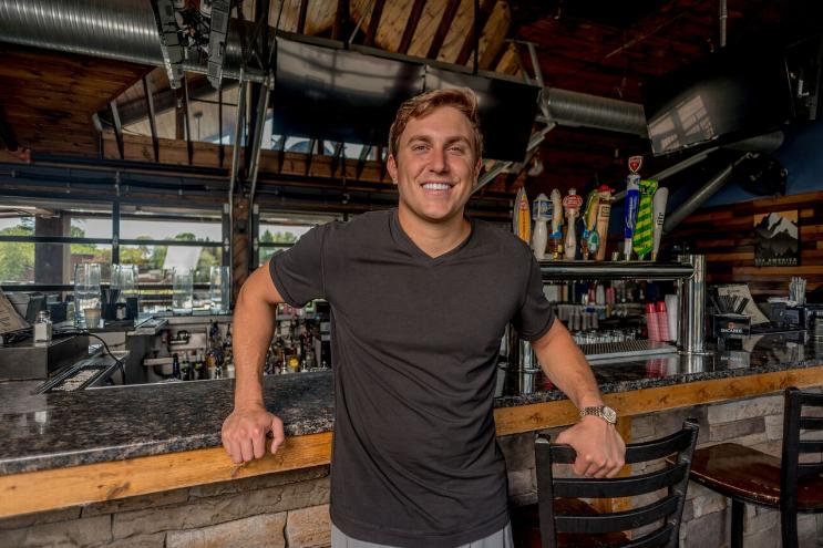 Evan Rosenberg at one of his co-owned bars, Big Sky Buckhead; Photo credit: Ian