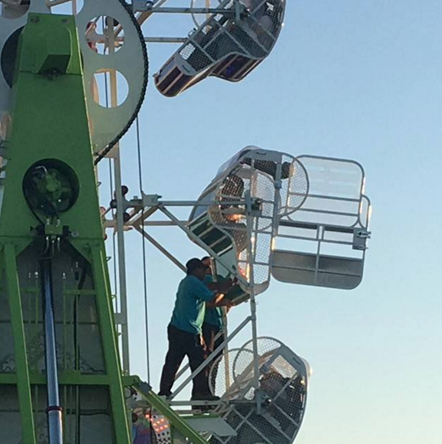 Employees helping children out of malfunctioned ride