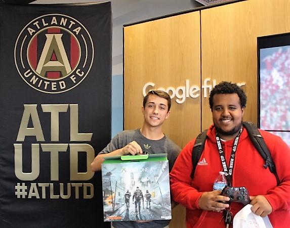 CREDIT: Jabari Kiongozi | Drew Macuga of ATLUTD presents a custom XBOX one to 2nd place contestant Abel Gottom.